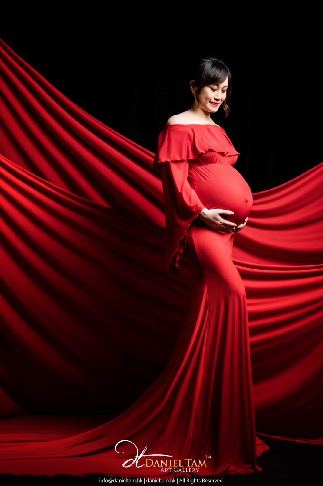 red gown pregnancy photo
